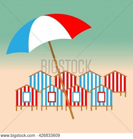 Summer Holiday Concept. Beach Umbrella And Beach Huts On The Seacoast
