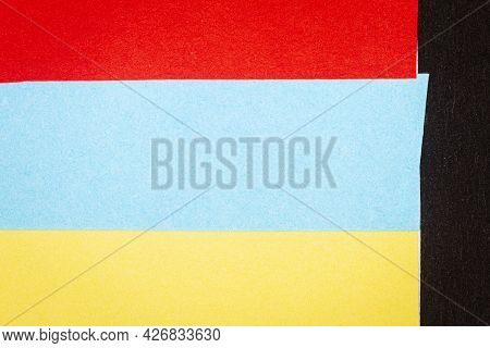 Multicolor Background From A Paper Of Different Colors. Abstract Colorful Vibrant Paper Textures.