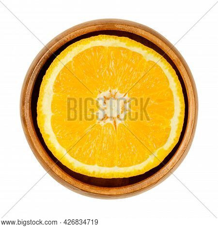 Orange Half, In A Wooden Bowl. Cross Section Of A Valencia Orange. Ripe And Sweet Fruit With Yellow,