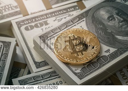 Siny Golden Bitcoin Coin Over Dollar Bills Background With Copy Space