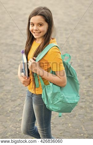 Back To School. Happy Teen Carry Backpack. Smiling Kid Hold Book. Childhood Happiness. Girl Ready Fo
