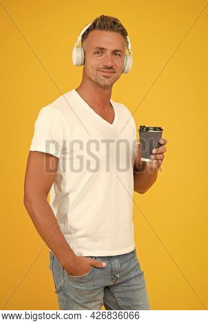 Drinking Takeaway Coffee Is A Way Of Life. Modern Man Drink Coffee Listening To Music. Takeaway And