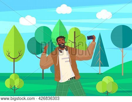 Young Guy Doing Live Streaming In Street. Video Blogging Concept. Social Media Network Blogger. Man