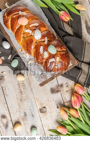 Portuguese Traditional Easter Cake. Folar With Eggs On Easter Table. Blossom Tulips, Colorful Painte
