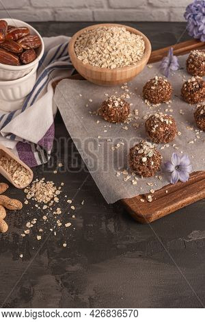Healthy Organic Energy Granola Balls With Oat Flakes, Peanuts, Dates, Cacao, Banana, Chocolate And H