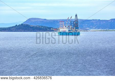 Rigs Offshore Oil Refinery Platform In Stavanger, Norway Fjord With Copy Space