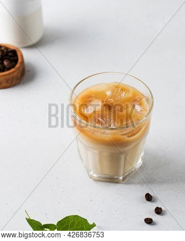 Cold Coffee With Ice And Cream On A White Background. Homemade Cold Latte.