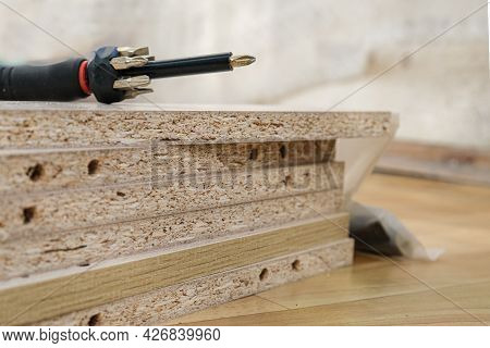 Screwdriver With Removable Nozzles For Assembling Furniture On Parts Of Cabinet Furniture Made Of La