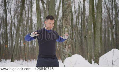 Outdoor Seasonal Sports. Full Length Portrait Of Positive Mature Guy Doing Exercises Before Jogging