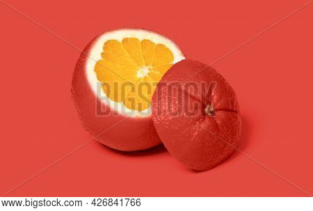 Weird Red Sliced Orange Isolated On A Pink Background