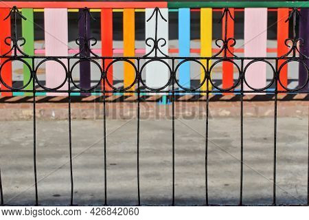 The Fence Is Made Of Rebar And The Fence Is Made Of Planks. The Concept Of Comparing Different Types