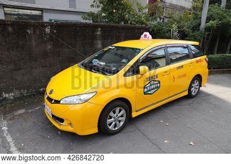 Taipei, Taiwan - December 4, 2018: Toyota Yellow Taxi Cab In Taipei, Taiwan. Taipei Is The Capital C