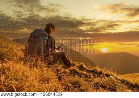 Traveler Woman Relaxing Meditation With Serene View Mountains. Girl Enjoying A View From The Top Of