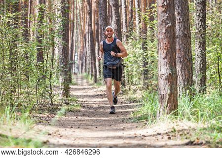 Running Man. Jogging Working Out In The Forest