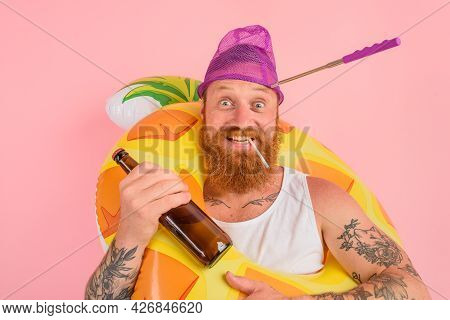 Happy Man Is Ready To Swim With A Donut Lifesaver With Beer And Cigarette