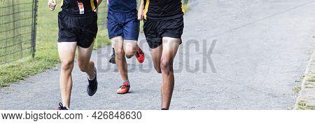 High School Boys Running A Race On A Gravel Path At Van Cortlandt Park.