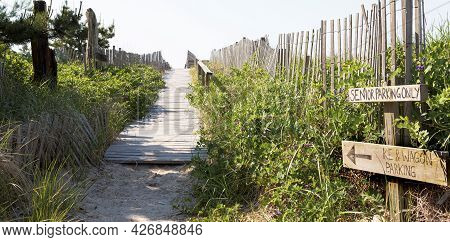 Path From Summer Homes To The Atlantic Ocean Beaches Of Fire Island With Wood On The Sand, Hand Rail