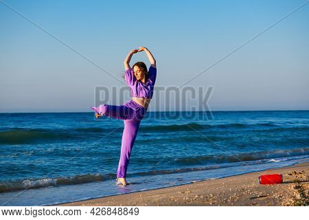 Girl Exercise At Sea Beach With Speaker