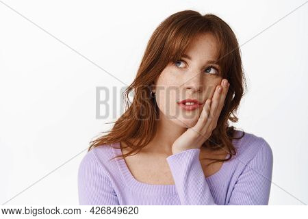 Gloomy And Bored Young Woman Roll Eyes, Staring At Upper Left Corner With Bored, Uninterested Face E