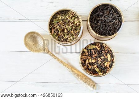 A Selection Of Loose Tea And A Pretty Gold Spoon.