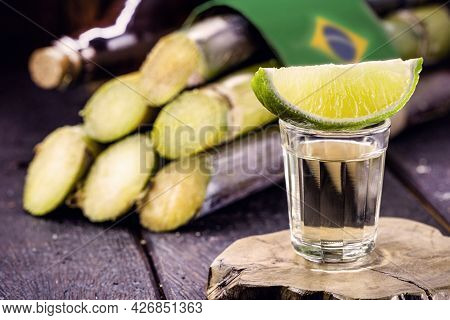 Glass Of Distilled Beverage Made From Sugar Cane, Called The Year Brazil De Pinga Or Cachaça, Concep