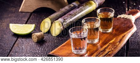 Glass Of Distilled Beverage Made From Sugar Cane, Called The Year Brazil De Pinga Or Cachaça.