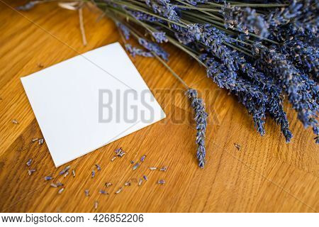 Lavender Flowers On Wooden Table, Copy Space.