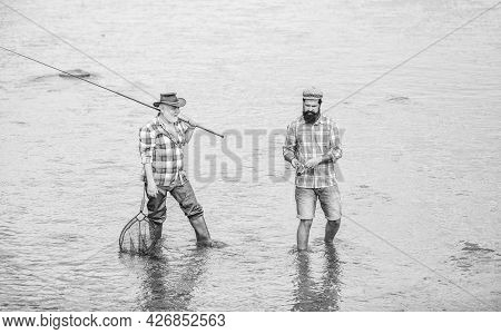 Best Friends. Father And Son Fishing. Poaching. Camping On The Shore Of Lake. Concept Of A Rural Get