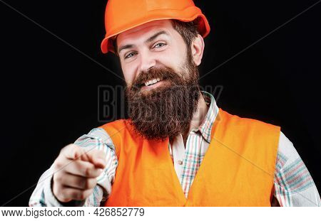 Portrait Of A Builder Smiling. Bearded Man Worker With Beard In Building Helmet Or Hard Hat. Man Bui