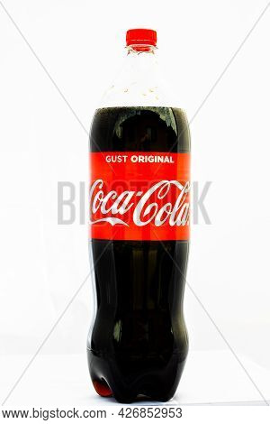 Coca-cola Plastic Bottle Isolated On White Background. Illustrative Editorial Photo Shot In Buchares