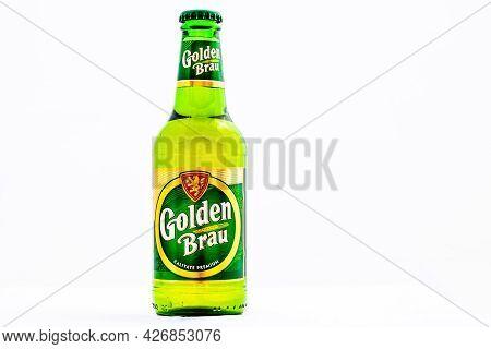 Bottle Of Golden Brau Beer Isolated On White. Illustrative Editorial Photo Shot In Bucharest, Romani