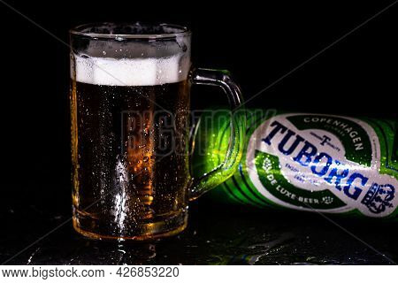 Can Of Tuborg Beer And Beer Glass On Dark Background. Illustrative Editorial Photo Shot In Bucharest
