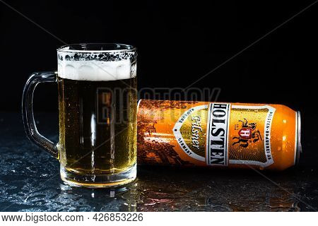Can Of Holsten Beer And Beer Glass On Dark Background. Illustrative Editorial Photo Shot In Buchares