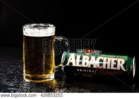Can Of Albacher Beer And Beer Glass On Dark Background. Illustrative Editorial Photo Shot In Buchare