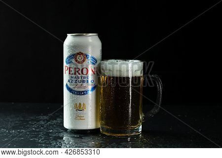 Can Of Peroni Nastro Azzurro Beer And Beer Glass On Dark Background. Illustrative Editorial Photo Sh