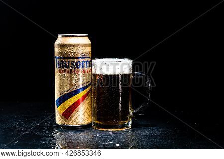 Can Of Timisoareana Beer And Beer Glass On Dark Background. Illustrative Editorial Photo Shot In Buc