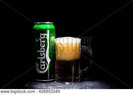 Can Of Carlsberg Beer And Beer Glass On Dark Background. Illustrative Editorial Photo Shot In Buchar