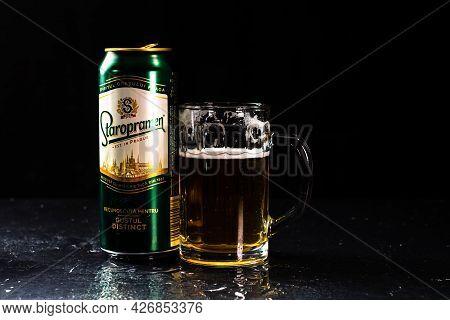 Can Of Staropramen Beer And Beer Glass On Dark Background. Illustrative Editorial Photo Shot In Buch