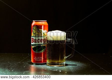 Can Of Bucegi Beer And Beer Glass On Dark Background. Illustrative Editorial Photo Shot In Bucharest