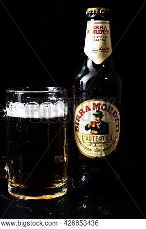 Can Of Birra Morreti Beer And Beer Glass On Dark Background. Illustrative Editorial Photo Shot In Bu