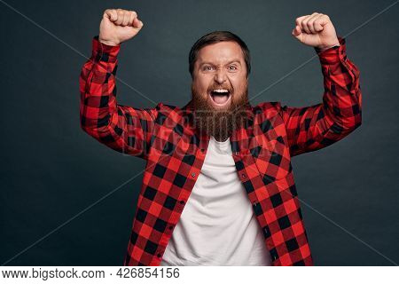 Delighted Young Macho Man, Football Fan Celebrating Victory Feeling Powerful And Encouraged, Fist Pu