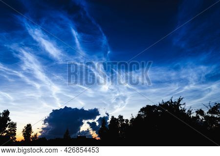 Mesospheric Clouds In The Darkening Evening Sky, A Rare Natural Phenomenon