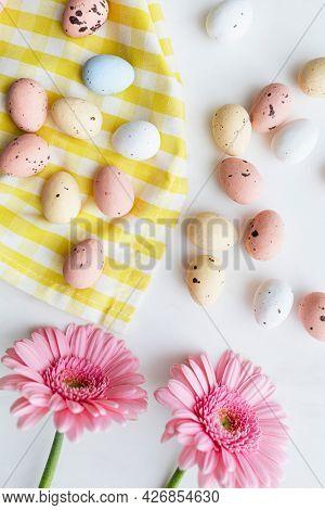 Chocolate Easter eggs and pink gerbera flatlay