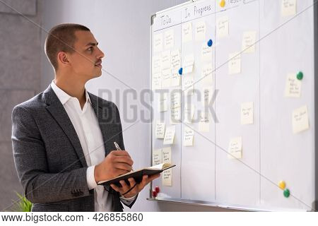 Writing On Kanban Business Board In Office