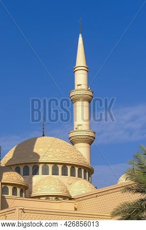 Minaret And Dome Of A Muslim Islamic Mosque In Abu Dhabi,uae On The Background Of The Blue Sky. Mina