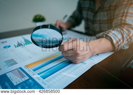 Businessman Or Auditor Hand Looking At Tax Fraud Investigation, Accounting Records, Financial Statem