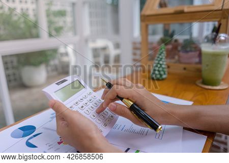 Businesswoman Or Accountant Working With Calculator, Business Document, Business Data, Accountancy D