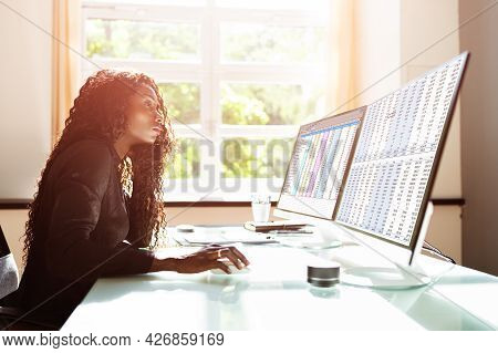 Data Analyst African Woman Using Spreadsheet On Computer