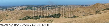Cambria, Ca, Usa - June 8, 2021: Panorama Landscape On Back Country With Dry Ranch Hills And Patches