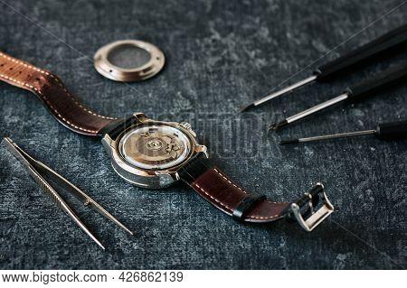 Open Wristwatch, Tweezers And Screwdrivers, Watch Repair Concept, Close Up, Shallow Depth Of Field